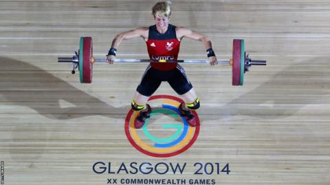 Michaela Breeze took 58kg weightlifting bronze with England's Zoe Smith winning gold.