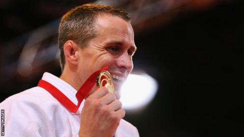 Euan Burton displays his gold medal