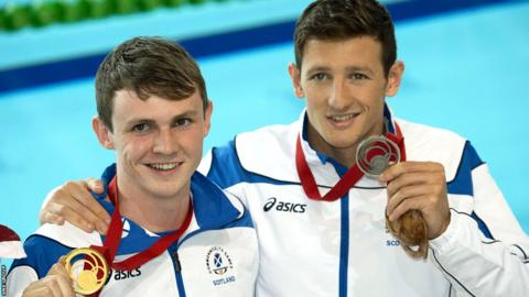 Ross Murdoch stunned red-hot favourite Michael Jamieson to win gold in the 200m breaststroke.