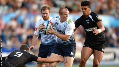 Dan Fish of Cardiff Blues is tackled by Chris Williams of Ospreys