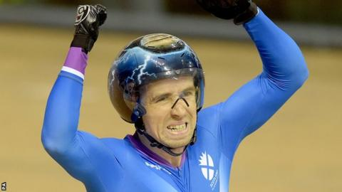 Neil Fachie celebrates his gold medal in the Para-Sport Sprint B Tandem