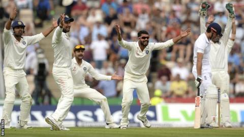 India appeal for the wicket of England's Alastair Cook