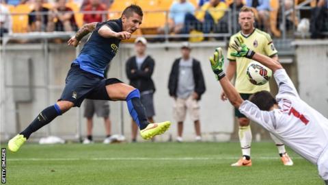 Stevan Jovetic scores past AC Milan goalkeeper Michael Agazzi