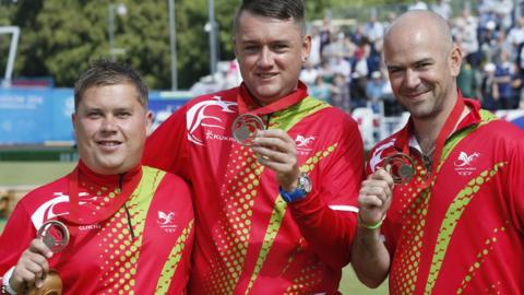 Lawn bowlers Paul Taylor, Jonathan Tomlinson and Marc Wyatt won bronze in the men's triples