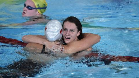Jazz Carlin is congratulated by Canada's silver medallist Brittany Maclean after winning gold in the 800m freestyle.