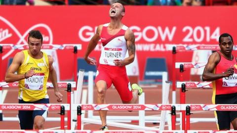 England's Andy Turner crashes out of the men's 110m hurdles