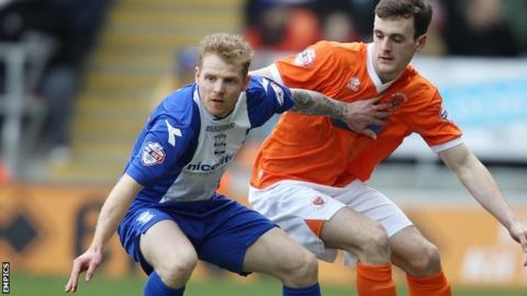 Blackpool's Jack Robinson (right) and Chris Burke (left) tussle for possession