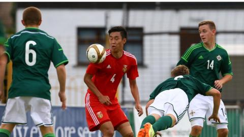 Action from Northern Ireland's victory over China at the Ballymena Showgrounds on Monday night