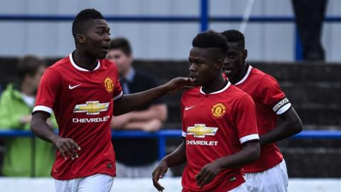 Manchester United players celebrate one of the 11 goals they scored against Gold Coast Academy in the Premier section