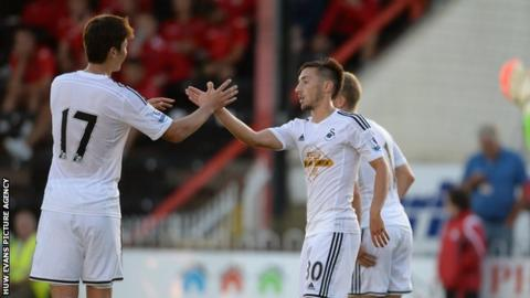 Josh Sheehan celebrates scoring for Swansea City