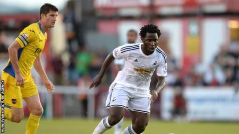 Swansea City striker Wilfried Bony in action against Exeter City