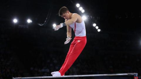 Gymnast Max Whitlock performs on the high bar