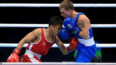 Wales' Ashley Williams (right) guaranteed himself a medal after beating Malaysia's Muhamad Fuad Mohd Redzuan in the men's light-flyweight quarter-final