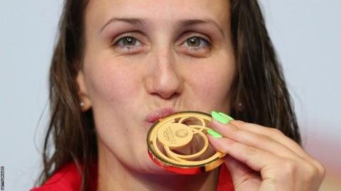 Georgia Davies won Wales' second gold medal at the swimming pool with victory in the 50m backstroke final.