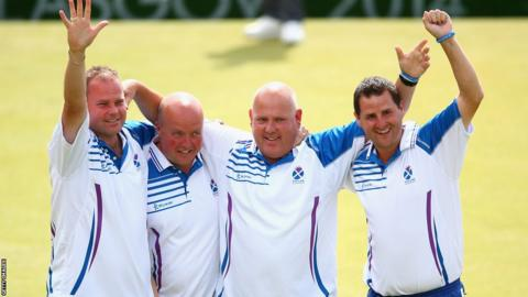 Scotland's fours celebrate their 16-8 win over England in the final. (Left to right) Paul Foster, David Peacock, Alex Marshall and Neil Speirs salute the crowd at Kelvingrove.