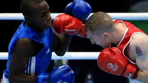 "Northern Ireland's Paddy Barnes (red) in action against Uganda""s Fazil Juma Kaggwa"