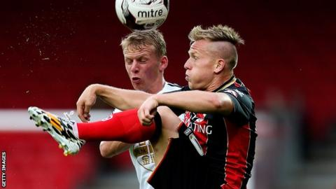 Matt Ritchie of Bournemouth holds off pressure from Stephen Kingsley of Swansea
