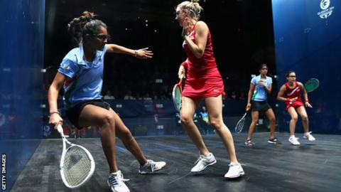 Dipika Pallikal of India is blocked by Laura Massaro of England during the Squash Women's Doubles Final between England and India