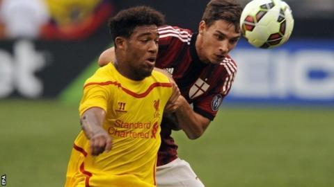 "Liverpools Jordon Ibe challenges AC Milan""s Mattia de Sciglio"