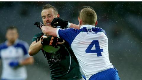 Kildare's Alan Smith and Monaghan's Colin Walshe battle for possession in the wet conditions at Croke Park
