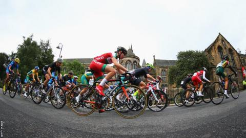 Wales' Amy Roberts rides past Glasgow University in the women's road race. Roberts finished 14th.