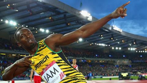 Usain Bolt celebrates a Jamaica win in the men's 4x100m relay at the 2014 Commonwealth Games
