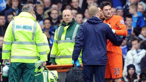 Tottenham goalkeeper Hugo Lloris (right) suffered a head injury against Everton but carried on playing