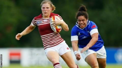 England's Lydia Thompson (l) in action against Samoa