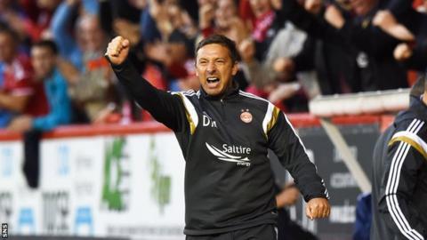 Derek McInnes celebrates after Mark Reynolds put Aberdeen in front against Real Sociedad