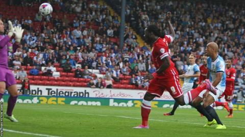 Kenwyne Jones scores the first goal of the Championship season to give Cardiff City a first half lead against Blackburn Rovers at Ewood Park