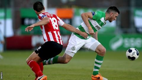 Shamrock Rovers's Ryan Brennan bursts past Philip Lowry at Tallaght Stadium
