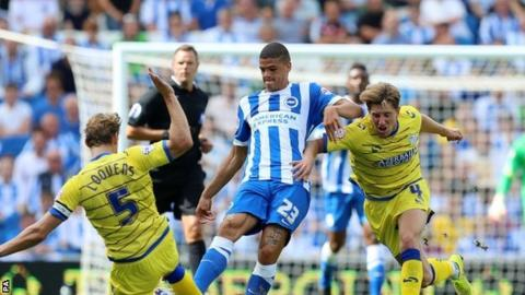 "Brighton's Shamir Fenelon (centre) is challenged by Sheffield Wednesday""s Glenn Loovens (l) and Sam Hutchinson (r)"