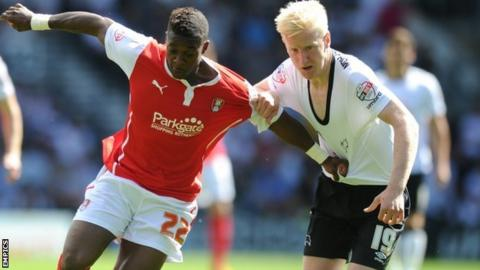 Rotherham United's Kieran Agard (l) and Derby County's Will Hughes battle for possession