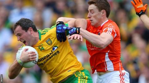 Donegal forward Michael Murphy is challenged by Charlie Vernon in the All-Ireland quarter-final
