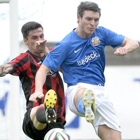 Declan Caddell of Crusaders battles for the ball with Kevin Braniff of Glenavon during the 2-2 draw at Mourneview Park