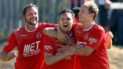 Tim Mouncey and Ross Redman celebrate with striker Gary Twigg who scored two of Portadown's goals in their 3-0 win over Linfield