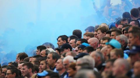 The blue of Dublin fills the air as home supporters on Hill 16 at Croke Park watch the All-Ireland champions power past Monaghan in the 2014 quarter-finals