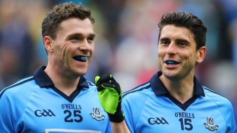 Dublin's Paddy Andrews and Bernard Brogan are happy after their side's convincing 2-22 to 0-11 victory over Monaghan at Croke Park