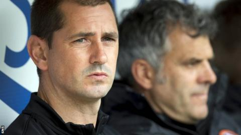 Dundee United manager Jackie McNamara watches on from the dugout as they defeat Aberdeen.