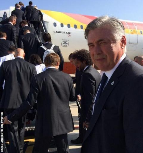 Carlo Ancelotti prepares to board a plane with his Real Madrid team as they head to Cardiff airport.