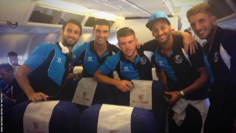 Jose Antonio Reyes (second left) and his Sevilla team-mates on the plane before their flight was delayed by a minor fault.