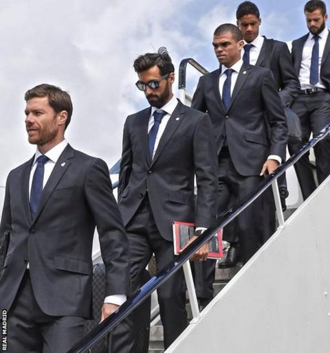 Real Madrid players, led by Xabi Alonso, set foot on Welsh soil at Cardiff Airport.