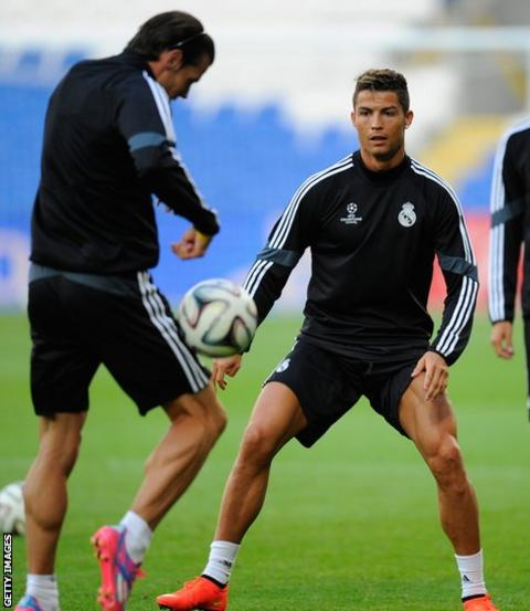 Gareth Bale and Cristiano Ronaldo train at Cardiff City Stadium on the eve of Real Madrid's Uega Super Cup match against Sevilla.
