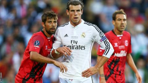 Sevilla defender Coke discovers the Real thing, keeping a close eye on Gareth Bale.
