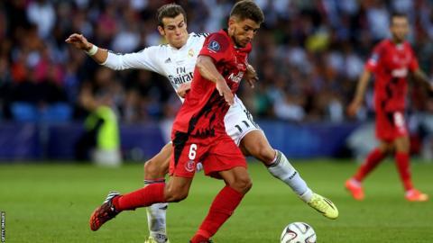 Bale tackles Sevilla's Daniel Carrico.