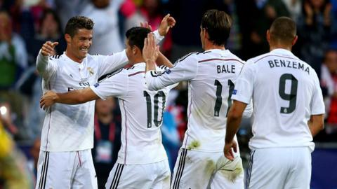 Ronaldo is congratulated by team-mates James Rodriguez, Bale and Karim Benzema.