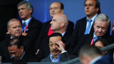 Cardiff City owner Vincent Tan takes his seat ahead of the Super Cup match.