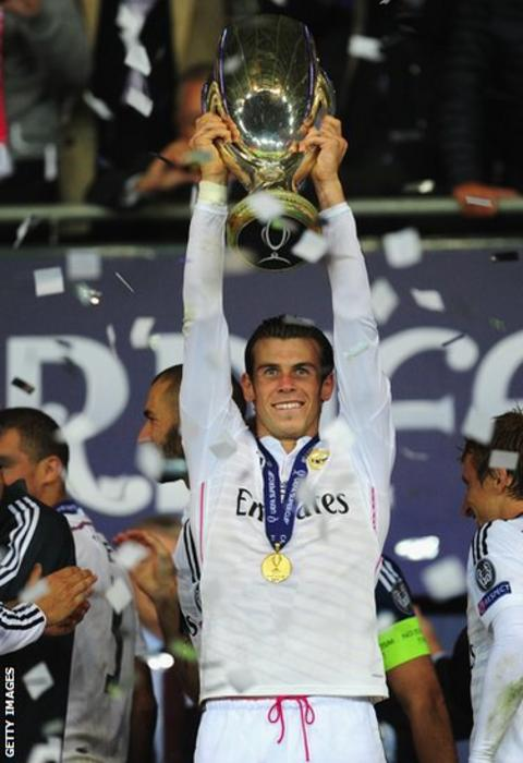 Gareth Bale holds aloft the Uefa Super Cup following Real Madrid's 2-0 win over Sevilla in Cardiff.