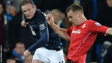 Ben Turner tries to block a Wayne Rooney shot