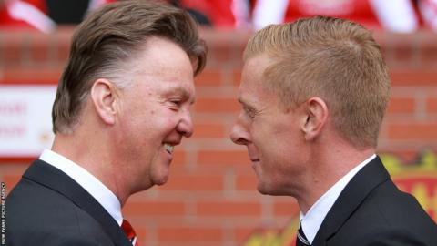 Swansea City boss Garry Monk is greeted by new Manchester United manager Louis van Gaal as the new Premier League season kicks off at Old Trafford.